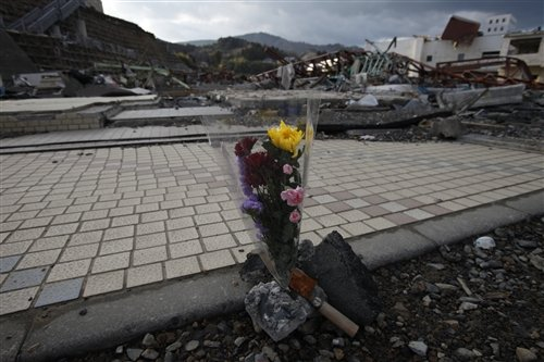 A bouquet of flowers left to the devastated city