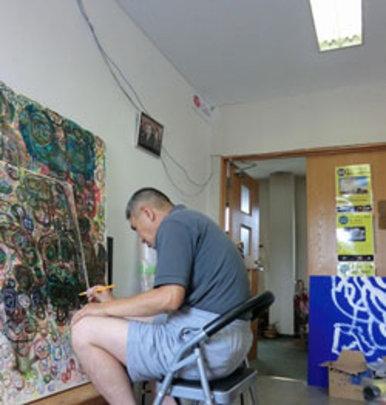 Artist at work after Runbini Museum's renovation