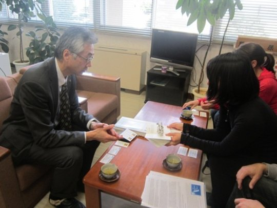 Giving Principal Yamagata a donor crane & message