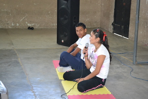 Marisol sings in front of the class