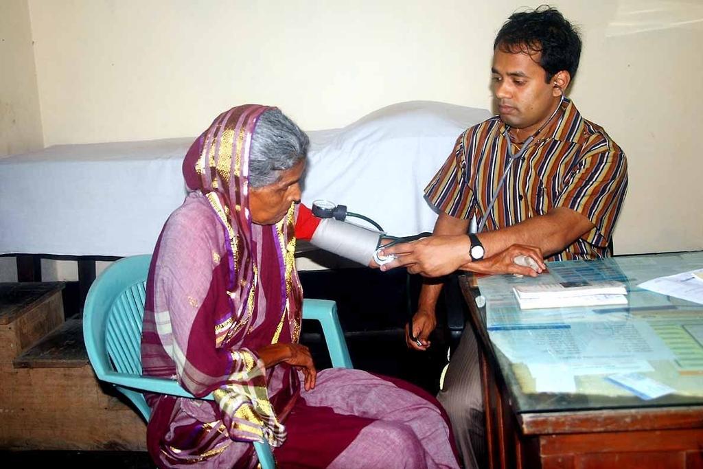 Doctor Examinig a Patient