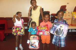 Children excited to receive new backpacks