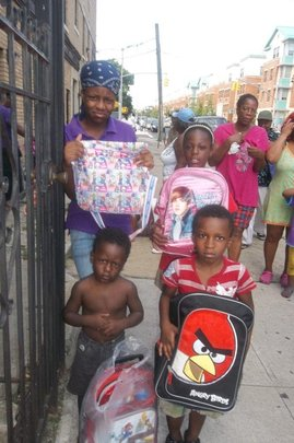 Family receiving backpacks & Clothing - NYC