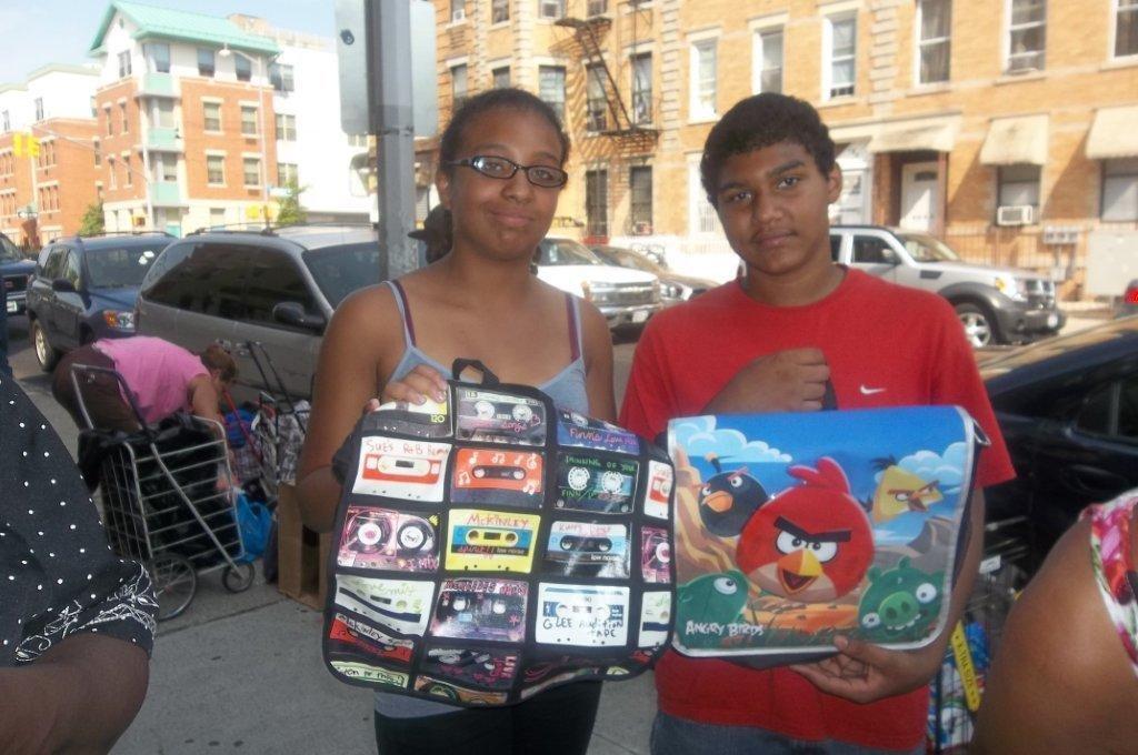Siblings Receiving Backpacks