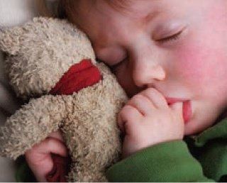 Sick child with teddy bear