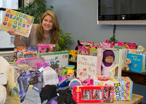 Sabrina with toy donations for children in need