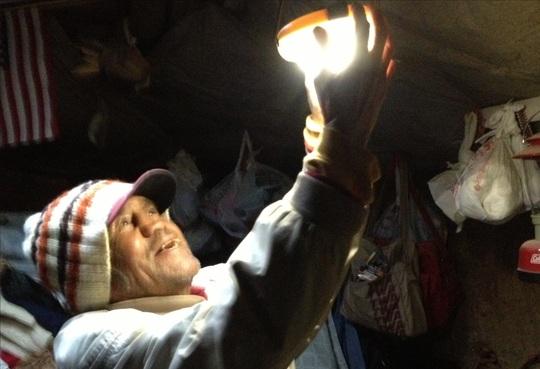 Lighting a Navajo Hogan