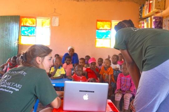 DAKTARI volunteers teaching at the creche