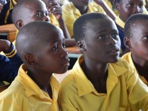 Primary School children listening to Grace.