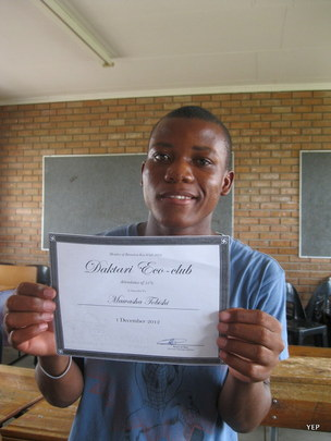 Thumisho showing his certificate of the club 2012.
