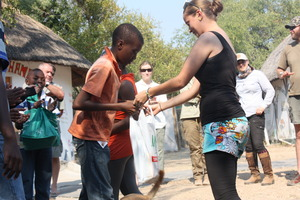 GVI's Beth is handing over the donated materials