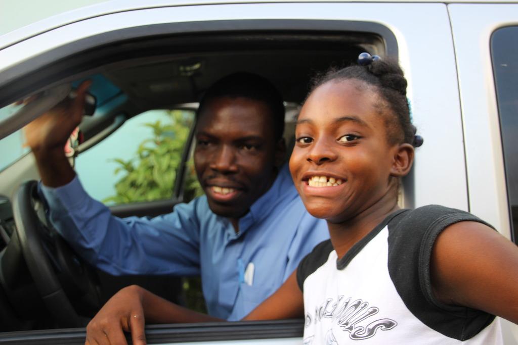Fr. Sadoni and Danika, a deaf student