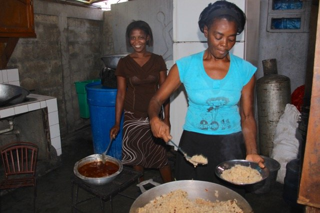 Kitchen workers preparing the day