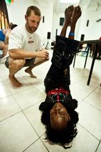 Jake treating Dieumene for back pain