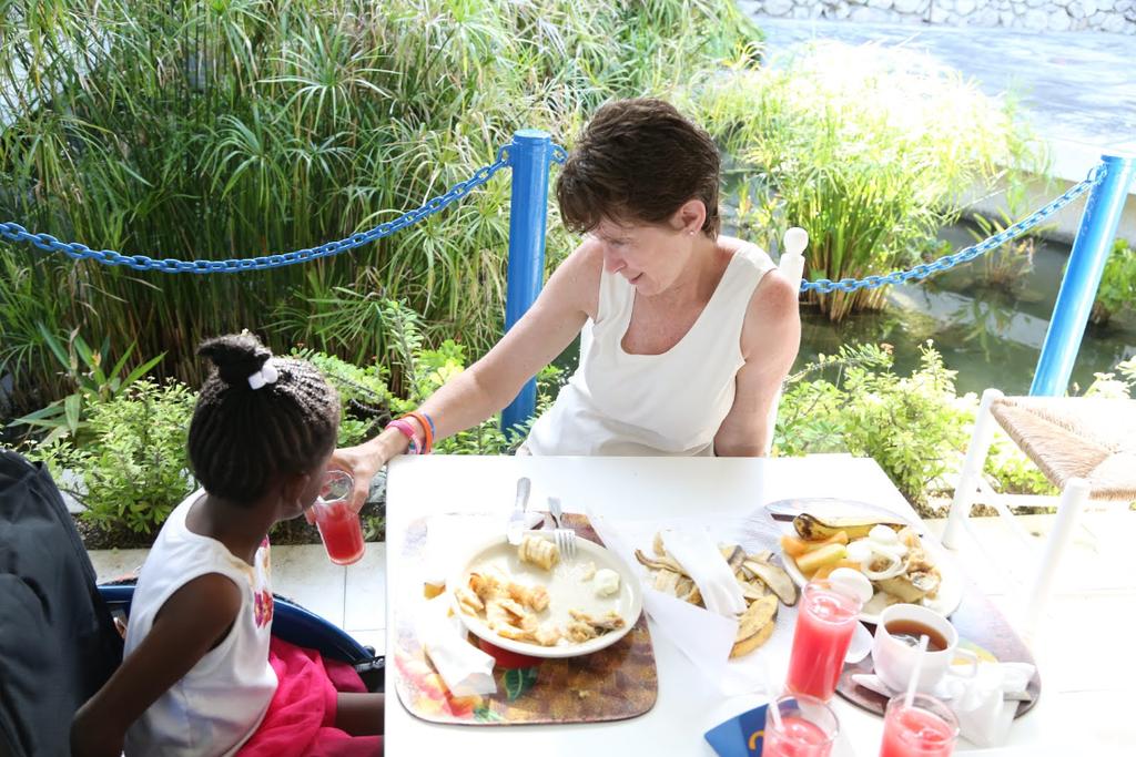 Kathy (TRTP President) feeding Dayana at Camp Jake