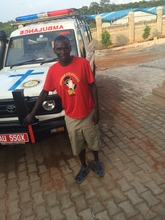 Julius Achon with new Ambulance