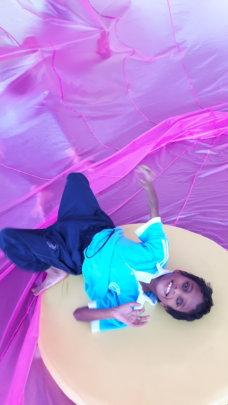 Look! I'm in a purple silk balloon!