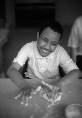 Faiz cutting through the dough into shapes