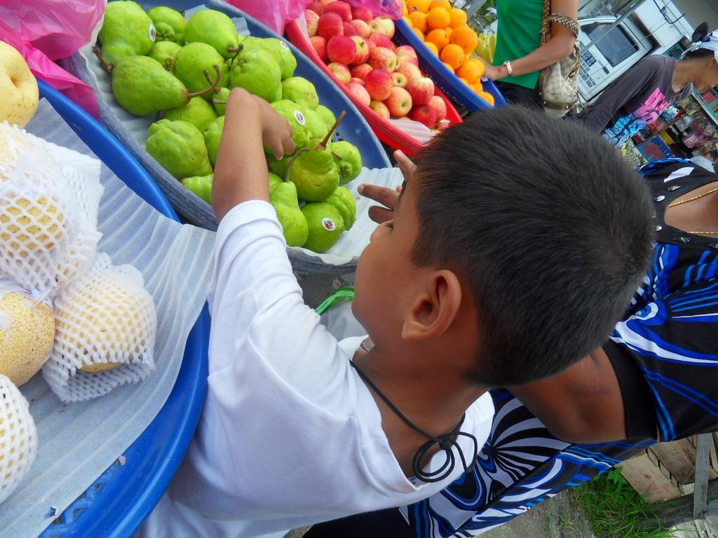 Dan using his motor skills to identify fruits