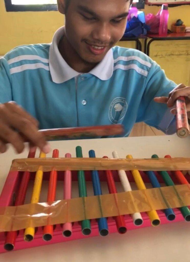 Daniel is playing xylophone