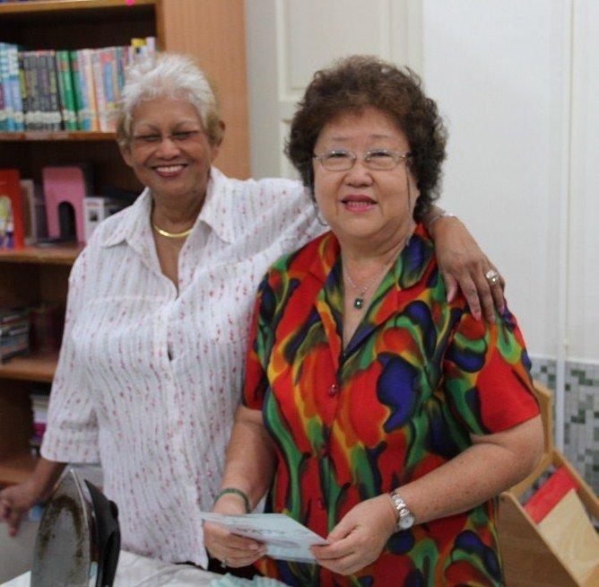 Volunteers Jenny & Ming help make teaching aids