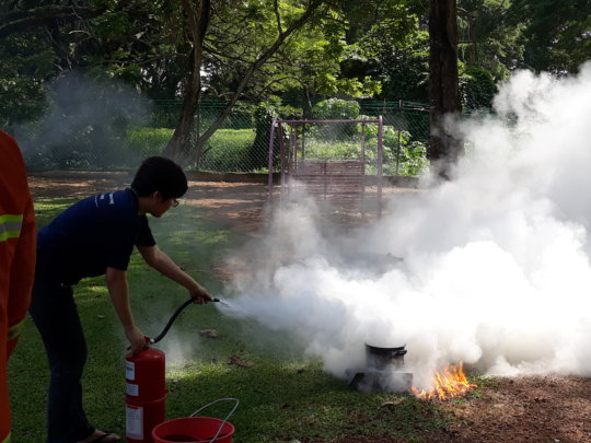 Our admin putting out fire during the drill