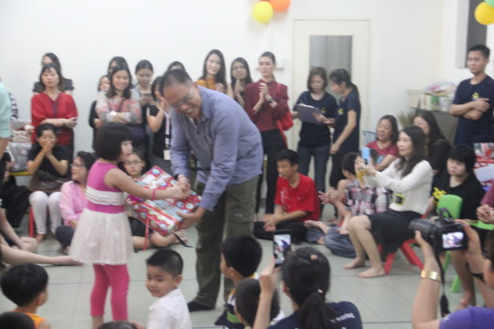 CSilk staff and clients giving out Christmas gifts