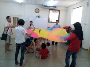 EIP playing colour parachute
