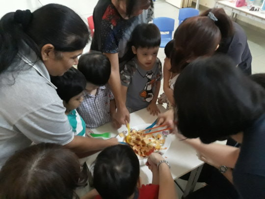 EIP tossing the yee sang during story time