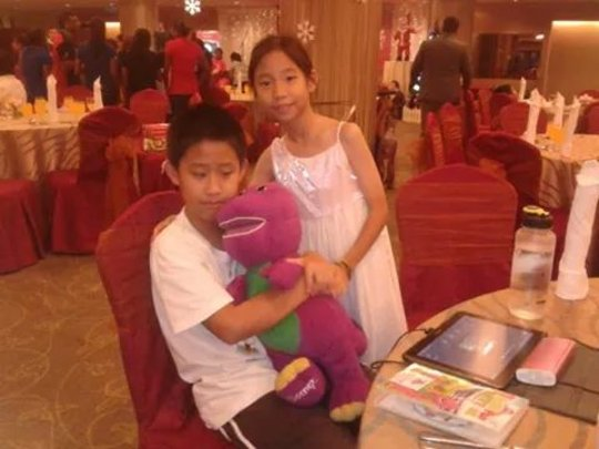 Our student with his gift from EQ Hotel Melaka
