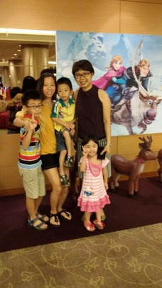 Our centre manager and a student's family in EQ
