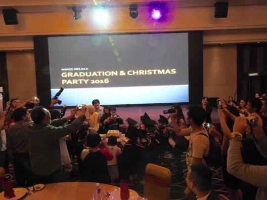 Cake cutting ceremony during our Graduation event