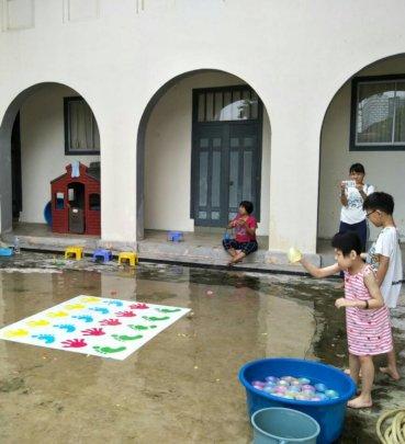 Kids playing water balloons on Fun Day
