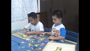 SAP students playing wooden puzzles