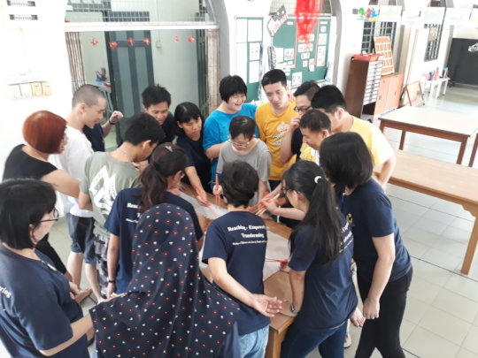 Staff & YAP trainees tossing the yee sang
