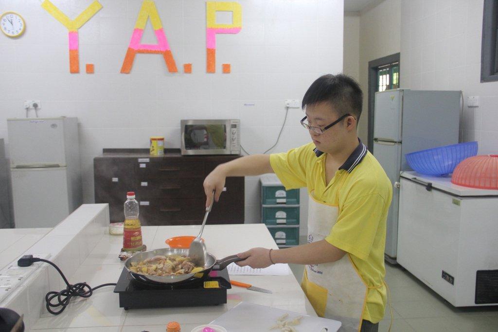 YAP: A trainee preparing lunch