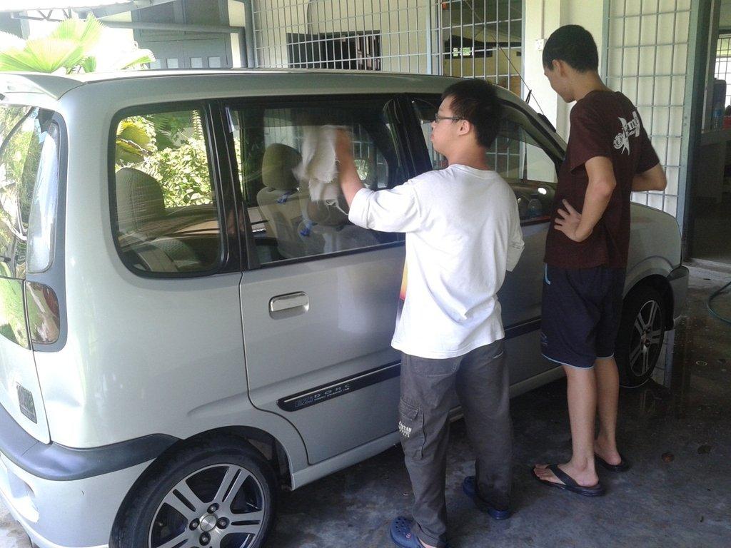YAP: Trainees polishing a car