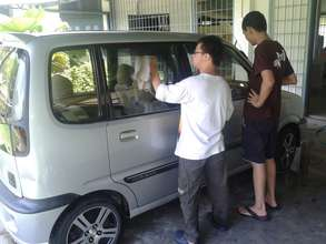 YAP: Trainees polishing a car