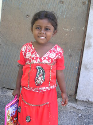 Slum girl attending to school at Ramarajunagar