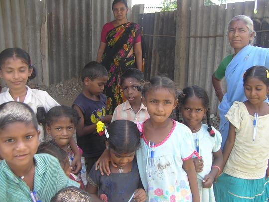 Teacher, children and care taker at Sundarayya col