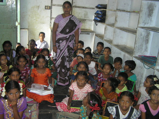 classroom in a slum at Swarnabharathinagar, Guntur