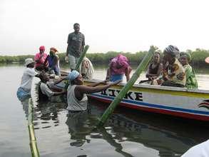 Women loading canoe