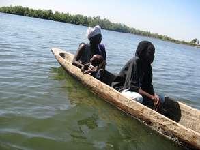 Women oyster farmers loading canoe