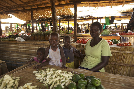 WGEF client and family in the market