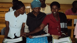 The women reading on their certificates