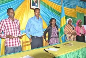 Leaders before giving the certificates to women