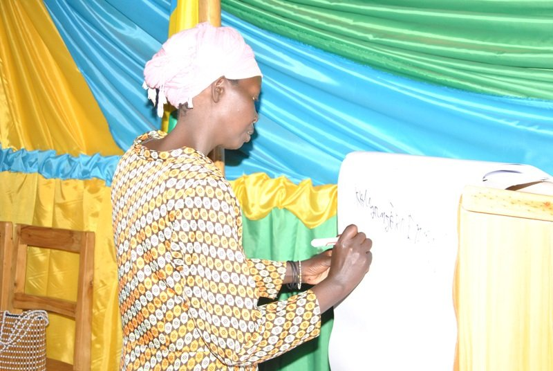 A woman writing on the flip chart