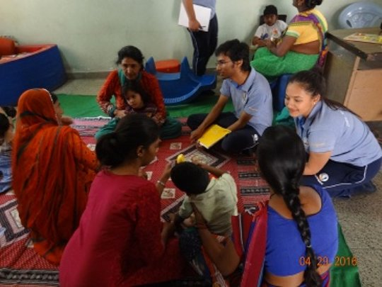 Students interacting with mothers