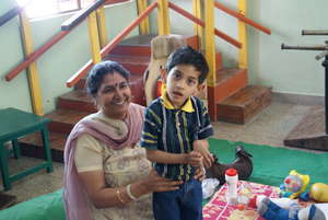 Child with a teacher at Early intervention Unit