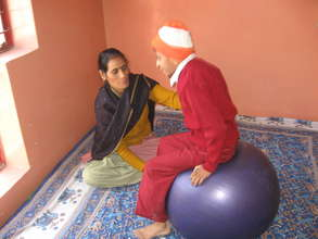 Child doing exercise with the help of teacher
